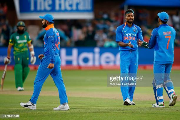 India bowler Hardik Pandya celebrates with teammates after dismissing South Africa batsman JP Duminy during the fifth One Day International cricket...