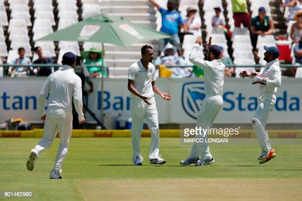 India bowler Hardik Pandya is celebrated by teammates after bowling out South Africa batsman Faf du Plessis during Day One of the cricket First Test...