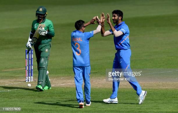 India bowler Jasprit Bumrah celebrates with Yuzvendra Chahal after bowling Bangladesh batsman Shakib Al Hasan during the ICC Cricket World Cup 2019...