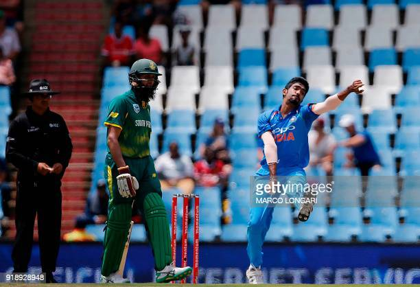 India bowler Jasprit Bumrah delivers past South Africa opening batsman Hashim Amla during the sixth One Day International cricket match between South...