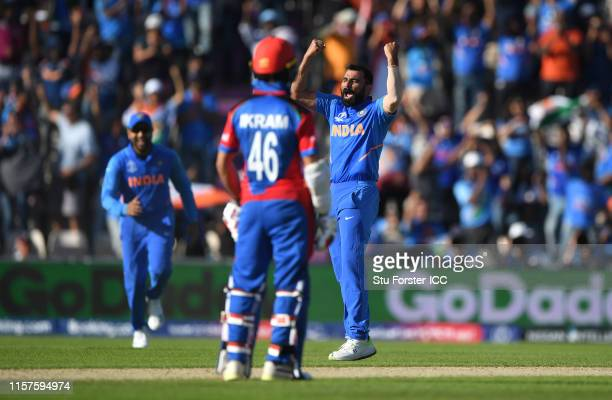 India bowler Mohammad Shami celebrates after dismissing Afghanistan batsman Mujeeb Zadran to complete his hat trick during the Group Stage match of...