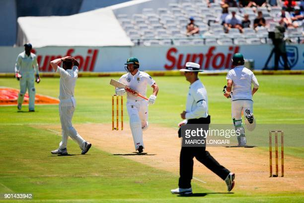 India bowler Mohammed Shami reacts as South Africa's batsman AB de Villiers scores a four during day one of the First Test between South Africa and...