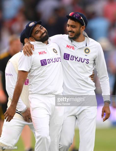 India bowler Mohammed Shami shares a joke with Axar Patel as they leave the field after bowling England out on day one during day one of the First...
