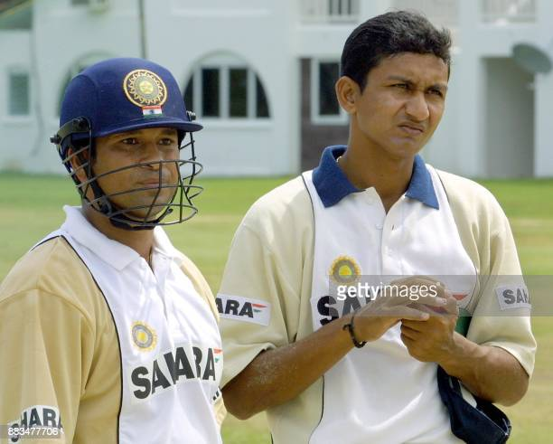 India bowler Sanjay Bangar watches batters along with Sachin Tendulkar during practice at the Jolly Beach Resort cricket field 08 May 2002 in...