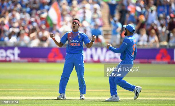 India bowler Siddarth Kaul celebrates with Virat Kohli after taking the wicket of Jos Buttler during the 3rd Vitality International T20 match between...