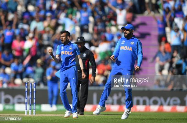 India bowler Yuzvendra Chahal celebrates with captain Virat Kohli after bowling Afghanistan batsman Ashgar during the Group Stage match of the ICC...