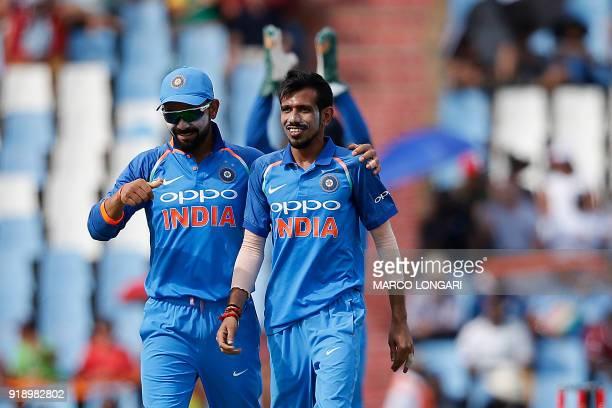 India bowler Yuzvendra Chahal celebrates with India captain Virat Kohli for dismissing South Africa batsman Khaya Zondo during the sixth One Day...
