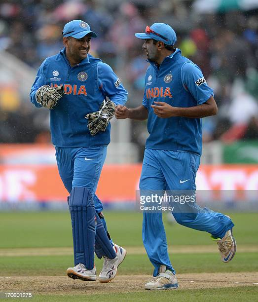 India captain MS Dhoni and Ravichandran Ashwin leave the field as rain stops play during the ICC Champions Trophy match between India and Pakiatan at...