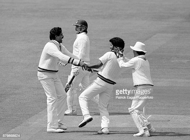 India captain Kapil Dev and wicketkeeper Kiran More congratulate Chetan Sharma on the wicket of England batsman Allan Lamb during the 1st Test match...