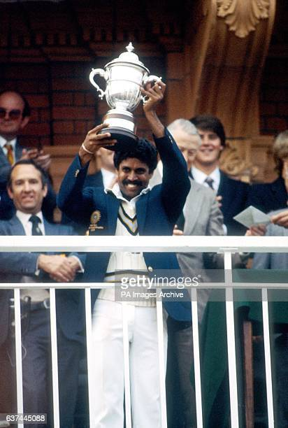 India captain Kapil Dev holds the Prudential World Cup aloft for the ecstatic Indian fans to see