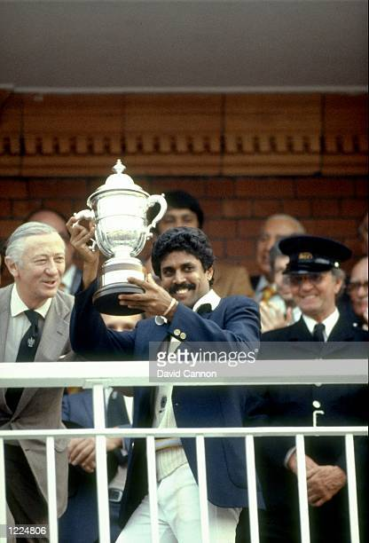 India Captain Kapil Dev holds the trophy aloft after the World Cup match against the West Indies at Lord's in London India won the match by 43 runs...