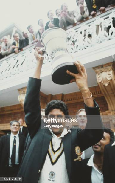 India captain Kapil Dev lifts the trophy on the balcony of the pavillion as Sunil Gavasker looks on after the 1983 Prudential World Cup Final victory...