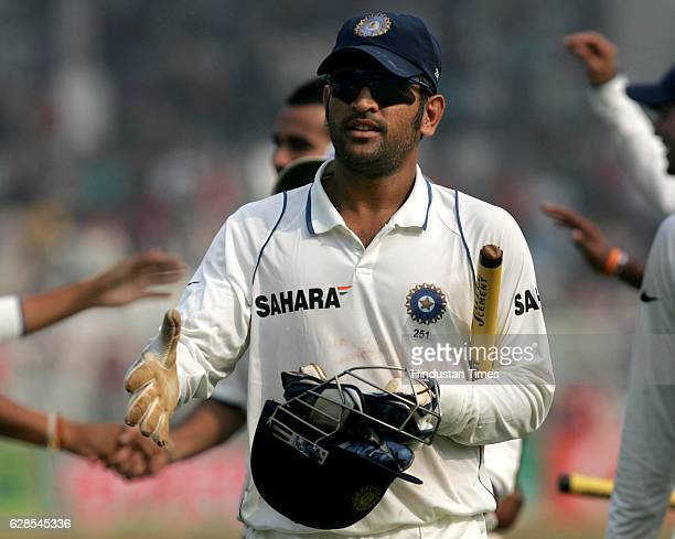 India captain M S Dhoni walks back to pavilion accepting praises after their win over Sri Lanka on the fifth day of the third test match between...
