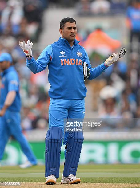India captain Mahendra Singh Dhoni instructs his team during the ICC Champions Trophy Group B match between India and West Indies at The Kia Oval on...