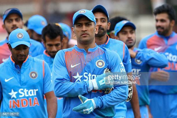 India captain Mahendra Singh Dhoni leads his team after victory during the third and final T20 cricket match in a serie of three games between India...