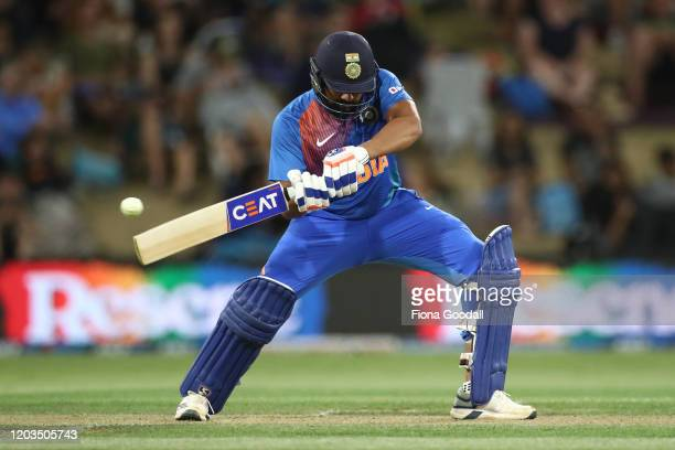 India Captain Rohit Sharma takes a shot during game five of the Twenty20 series between New Zealand and India at Bay Oval on February 02, 2020 in...