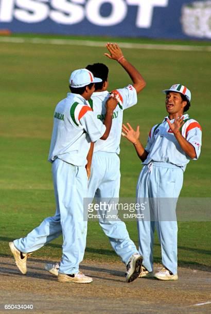 India captain Sachin Tendulkar looks rather pleased after teammate Saurav Ganguly dismissed West Indies' Carl Hooper
