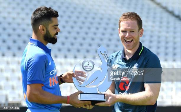 India captain Virat Kohli and England captain Eoin Morgan hold the Royal London series trophy at Trent Bridge on July 11 2018 in Nottingham England