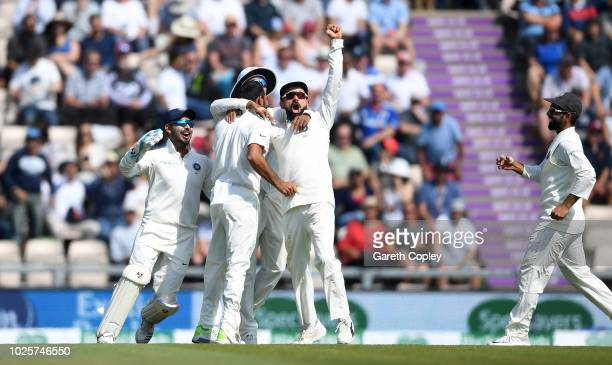 India captain Virat Kohli and Rishabh Pant celebrate with Mohammed Shami after dismissing Jonathan Bairstow of England during day three of the...