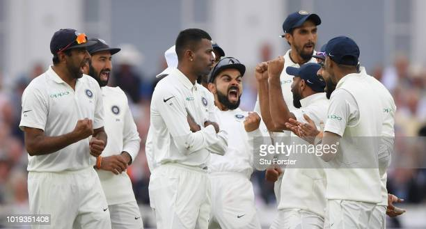 India captain Virat Kohli and team mates celebrate after Joe Root is given out after a review during day two of the 3rd Specsavers Test Match between...