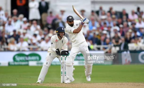 India captain Virat Kohli bats watched by England wicketkeeper Jos Buttler during day three of the Specsavers 3rd Test match between England and...
