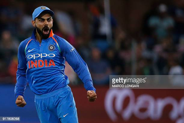 India captain Virat Kohli celebrates after bowler Hardik Pandya dismissed South Africa batsman JP Duminy during the fifth One Day International...