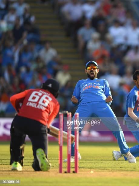 India captain Virat Kohli celebrates after England batsman Joe Root is bowled during the 2nd Vitality T20 International between England and India at...