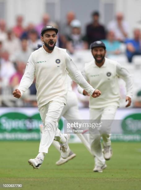 India captain Virat Kohli celebrates after India had dismissed Joe Root during day four of the 3rd Specsavers Test Match between England and India at...