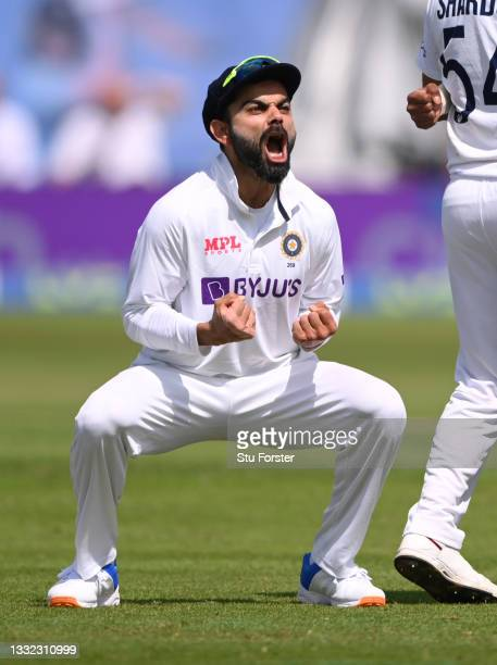India Captain Virat Kohli celebrates after the review against Zak Crawley by bowler Mohammed Siraj is given out during day one of the First Test...