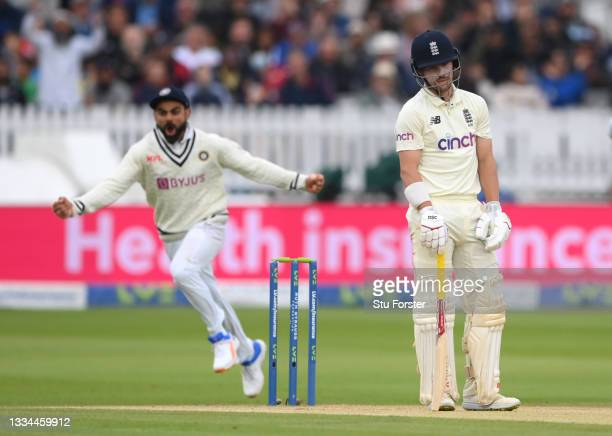 India captain Virat Kohli celebrates as Rory Burns reacts after being dismissed for 0 during day five of the second Test Match between England and...