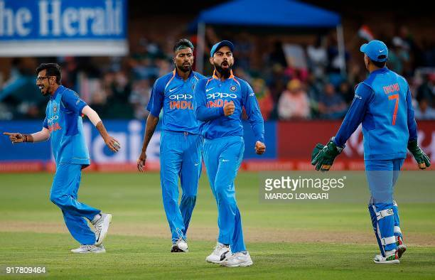 India captain Virat Kohli celebrates bowler Hardik Pandya after he dismissed South Africa batsman JP Duminy during the fifth One Day International...