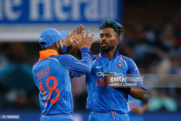 India captain Virat Kohli celebrates with bowler Hardik Pandya after the dismissal of South Africa batsman JP Duminy during the fifth One Day...