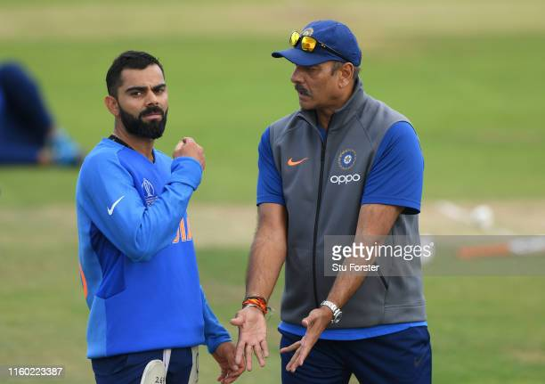 India captain Virat Kohli chats with coach Ravi Shastri during India nets ahead of their Cricket World Cup Match against Sri Lanka at Headingley on...