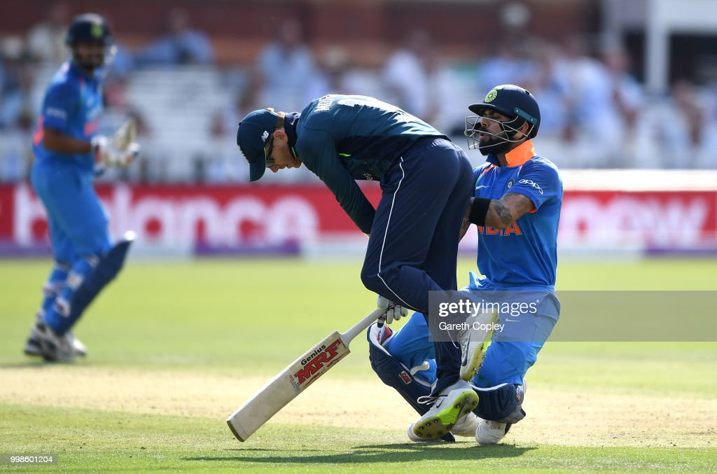 India captain Virat Kohli collides with England captain Eoin Morgan during the 2nd ODI Royal London One-Day match between England and India at Lord's Cricket Ground on July 14, 2018 in London, England.