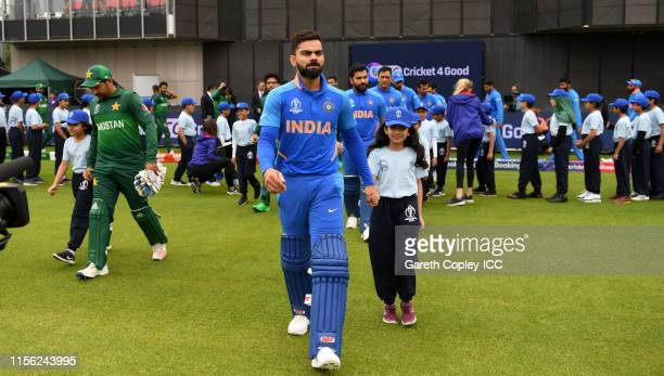 India captain Virat Kohli leads out his team alongside Pakistan captain Sarfaraz Ahmed ahead of the Group Stage match of the ICC Cricket World Cup...