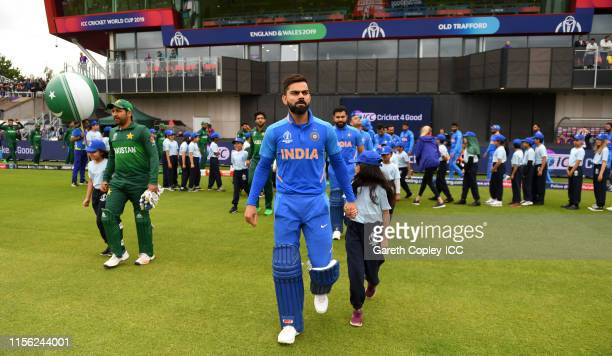 India captain Virat Kohli leads out his team alongside Pakistan captain Sarfaraz Ahmed ahead of the Group Stage match of the ICC Cricket World Cup...