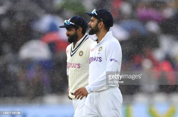 India captain Virat Kohli leaves the field when rain stops play in the final session during day three of the First Test Match between England and...