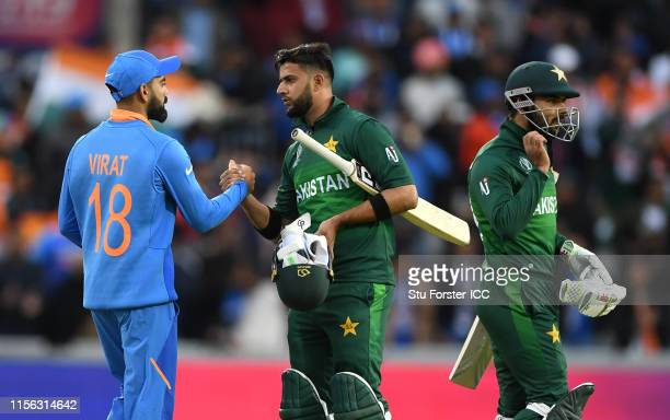 India captain Virat Kohli shakes hands with Pakistan batsman Imad Wasim after the Group Stage match of the ICC Cricket World Cup 2019 between India...