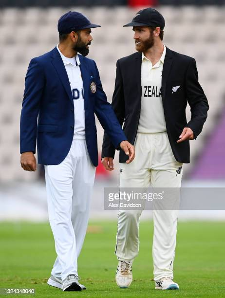India captain Virat Kohli speaks to New Zealand captain Kane Williamson after the toss on Day 2 of the ICC World Test Championship Final between...