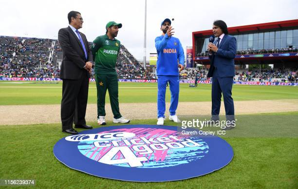 India captain Virat Kohli tosses the coin alongside Pakistan captain Sarfaraz Ahmed ahead of the Group Stage match of the ICC Cricket World Cup 2019...
