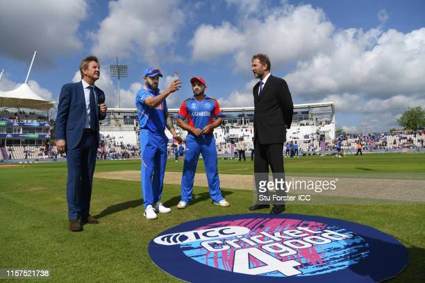 India captain Virat Kohli tosses the coin before the Group Stage match of the ICC Cricket World Cup 2019 between India and Afghanistan at The Ageas...