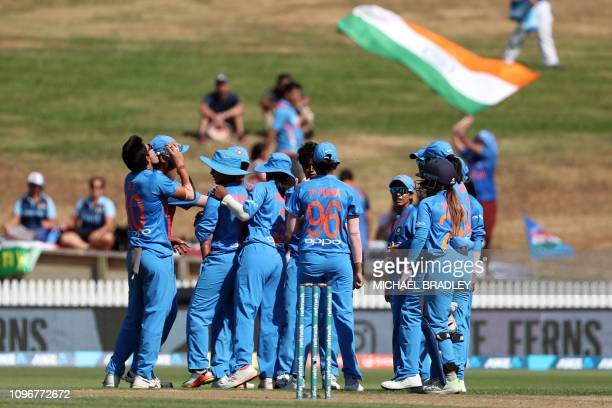 India celebrate after taking the wicket of New Zealand's Suzie Bates during the third Twenty20 international women's cricket match between New...