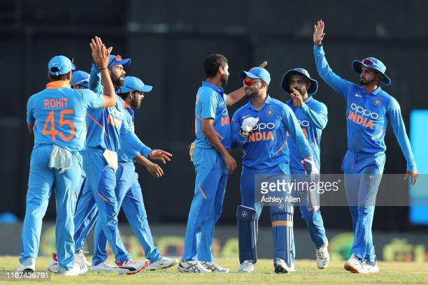 India celebrate another wicket during the second MyTeam11 ODI between the West Indies and India at the Queen's Park Oval on August 11 2019 in Port of...