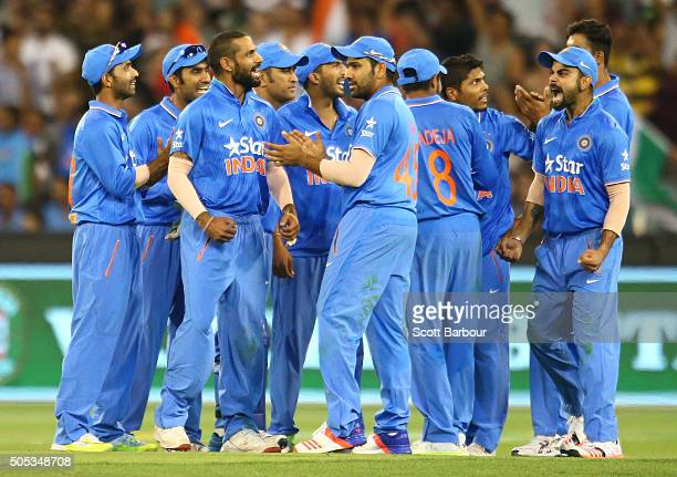 India celebrate as Mitchell Marsh of Australia is run out by MS Dhoni of India during game three of the One Day International Series between...