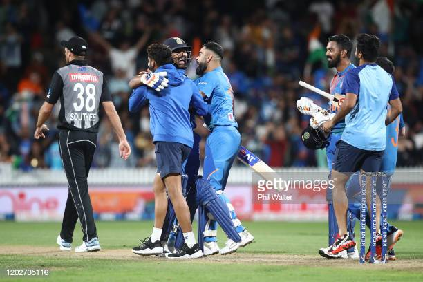 India celebrate at the end of game three of the Twenty20 series between New Zealand and India at Seddon Park on January 29, 2020 in Hamilton, New...