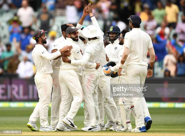 India celebrate getting the final wicket and winning the test match during day five of the First Test match in the series between Australia and India...