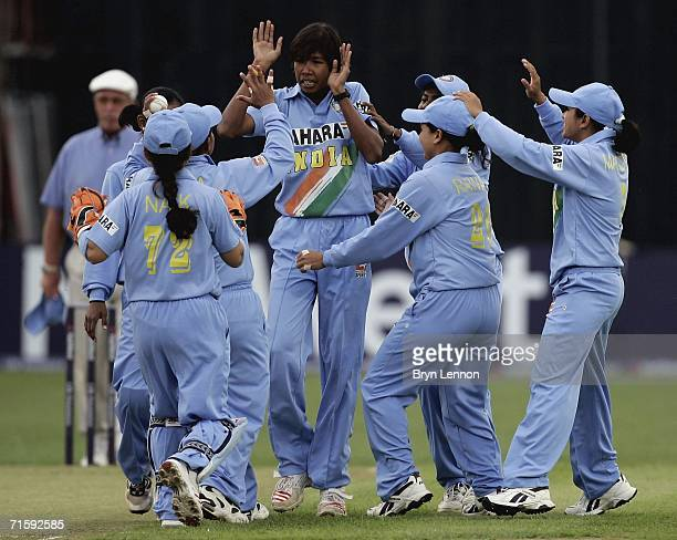 India celebrate taking a wicket during the NatWest Women's Twenty20 International match between England and India at The County Ground on August 5...