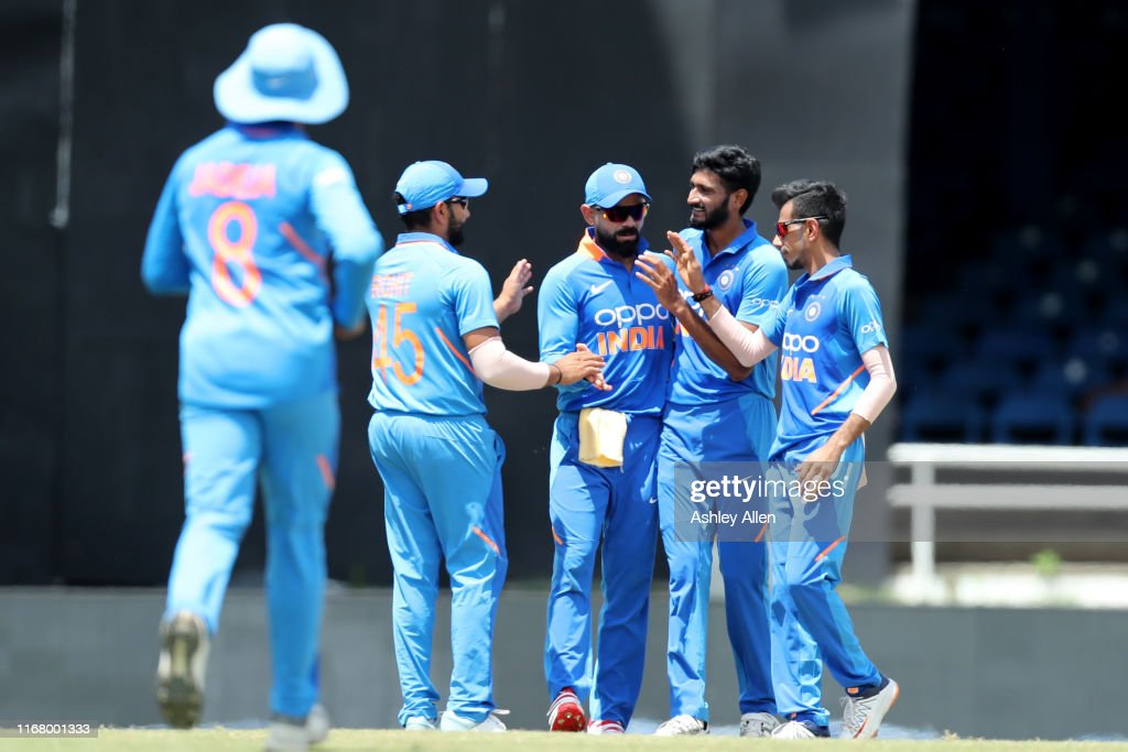 India celebrate the dismissal of Chris Gayle of the West