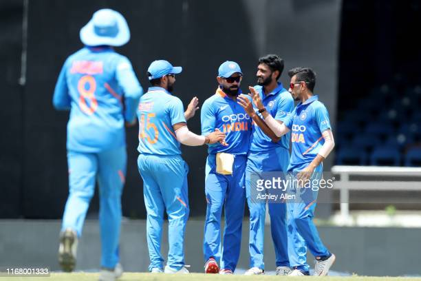 India celebrate the dismissal of Chris Gayle of the West Indies during the third MyTeam11 ODI between the West Indies and India at the Queen's Park...