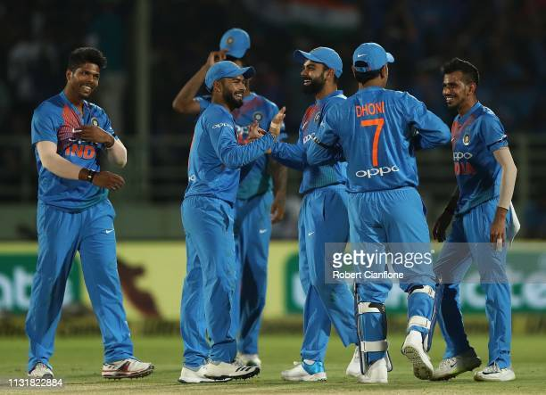 India celebrate the wicket of D'Arcy Short of Australia during game one of the T20I Series between India and Australia at ACAVDCA Stadium on February...